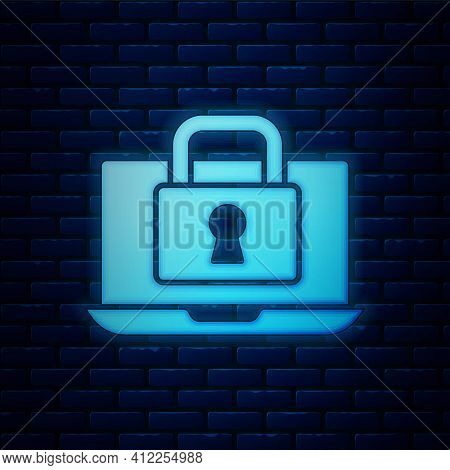 Glowing Neon Laptop And Lock Icon Isolated On Brick Wall Background. Computer And Padlock. Security,