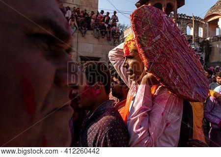 March 2021 Vrindavan,mathura. People Celebrating Holi At Barsana On Holi Festival With Selective Foc