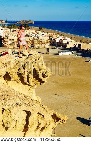 Tourist Woman On Eroded Yellow Sandstone Formations, Enchanted City Of Bolnuevo, Murcia Spain. Touri