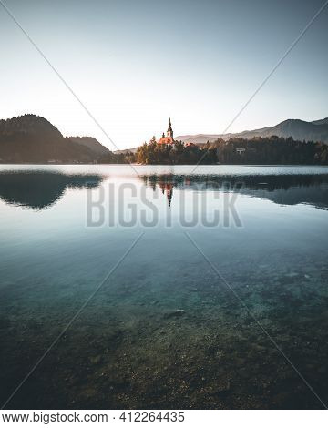 Lake Bled With Island, Church, Mountains Background, Slovenia On Summer Morning