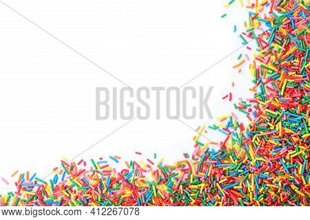 Colorful Sprinkles On White Background, Top View. Confectionery Decor
