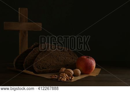 Bread, Apple, Walnuts And Cross On Wooden Table, Space For Text. Great Lent Season