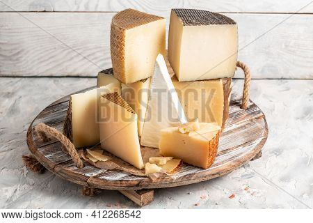 Petit Basque, French Cheese, Cheese Board Of Various Types Of Soft And Hard Cheese. Spanish Manchego
