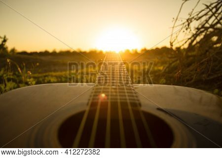 Guitar During The Sunset.playing Guitar With Some Friends During The Golden Hour In The Nature,just