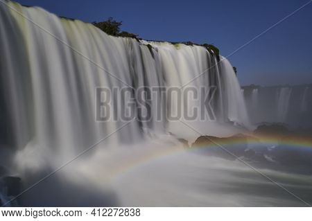 Iguazu Falls Or Iguacu Falls, On The Border Of Argentina And Brazil, Are The Largest Waterfall In Th