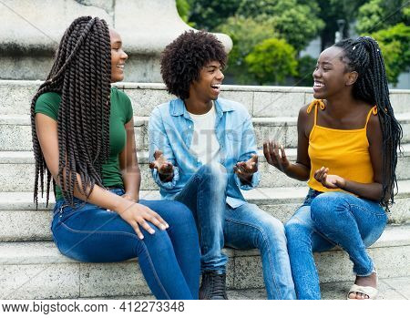 Laughing Group Of African American Female And Male Young Adults Outdoor In Summer In City