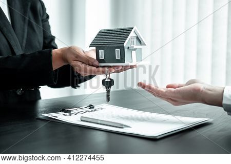 Sale Estate Agent Giving House Model And Key To New Client After Signing Agreement Contract With App