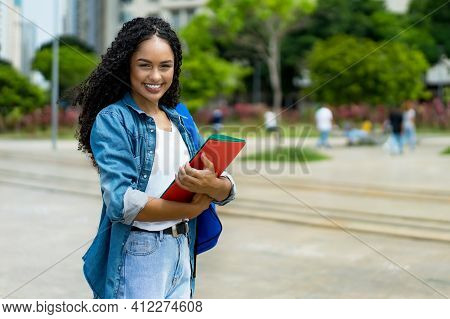 Awesome Latin American Young Adult Student With Retainer Outdoor In Summer In City