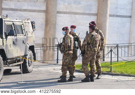 Pisa, Italy - March 10, 2021 - Italian Soldiers Wearing Surgical Masks Guard The Entrance To The Lea