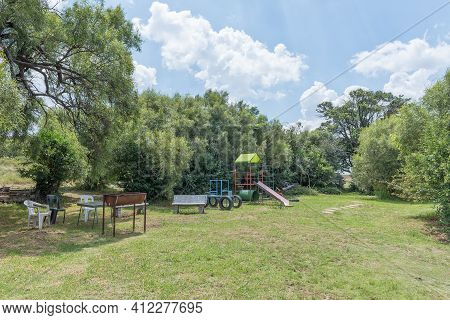 Bloemfontein, South Africa - February 27, 2021: View Of A Barbeque Area And Childrens Playground At