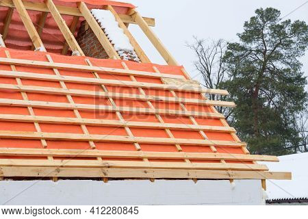 Installing Roof Boards And Vapor Barriers For Metal Tiles In Winter Time.