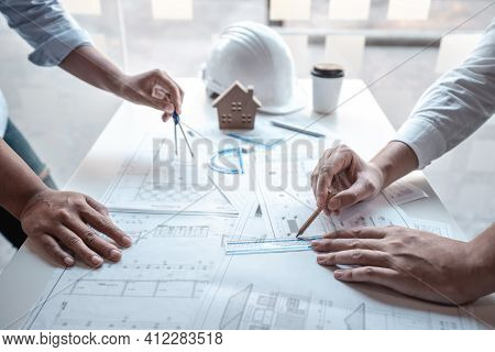 Team Of Architects Or Engineering Consulting And Analyzing Working On Objects Tools And Construction