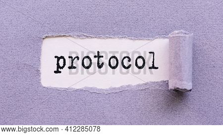 The Text Protocol Appears On Torn Lilac Paper Against A White Background.