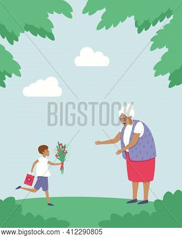 The Grandson Runs With Flowers And A Gift To His Grandmother. Holiday. The Boy Is Glad That He Saw H