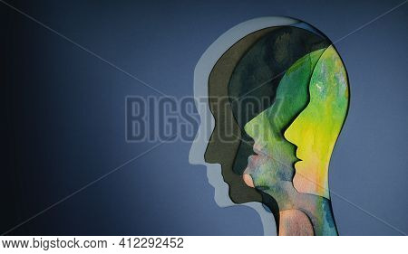 Mental Health Concept. Bipolar Disorder Person. Layers Of Paper Cut As Human Head Presenting Differe