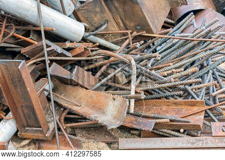 Pile Of Scrap Metal With Concrete Steel And Construction Equipment