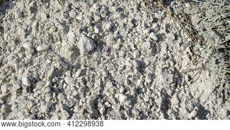 Small Stones Of Natural Chalk. Chalk Mountain Texture. Native Chalk. Chalk Mining Background Or Natu