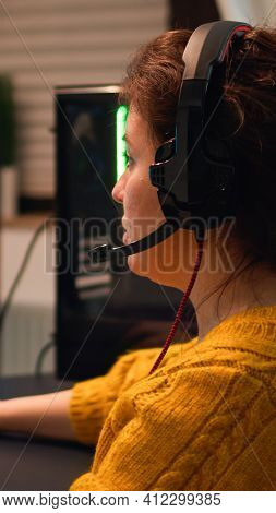 Professional Esport Woman Gamer Using Mic Of Headset Talking Playing Shooter Game With Team On Strea