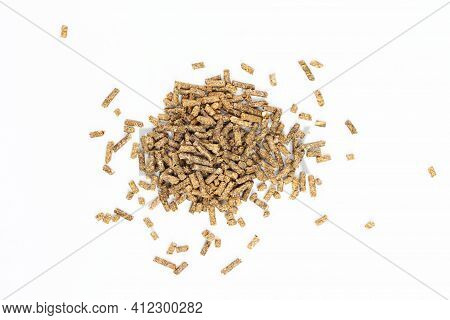 Feed For Livestock. Pig Feed Pellets,feed  For Hamster, Rabbits Or Mouse On A White Background. Top