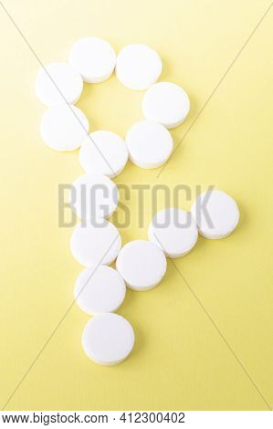 A Flower Of Round White Pills On A Yellow Background. The Concept Of Medicine And Medical Care