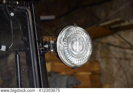 A Close Up Of A Headlight Of A Tractor
