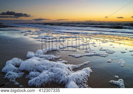 Peaceful And Tranquil Zen-like Sunset On The Beach With Beautiful Reflections On The Water - North S