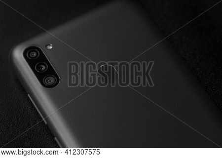 Selective Focus On Back Of New Smartphone Samsung Galaxy M11 Triple Camera And Fingerprint Sensor. B