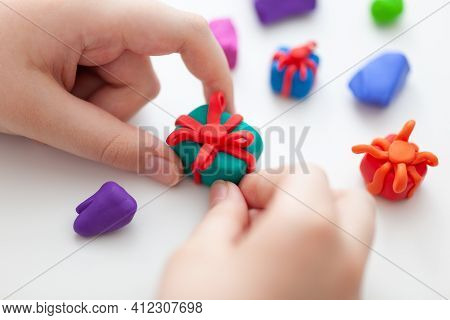 A Young Boy Making Polymer Clay Gift Boxes. Shallow Depth Of Field. Close Up.