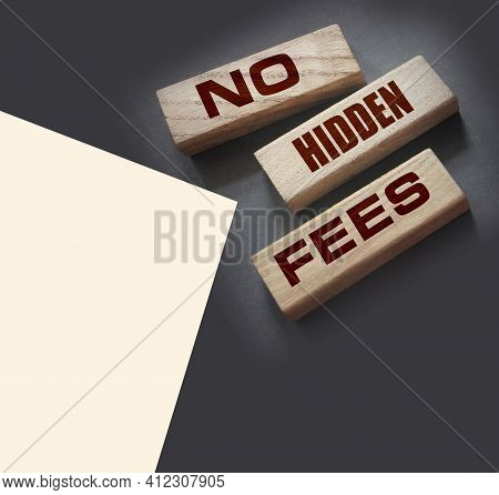 No Hidden Fees Word Written On Wood Block. Taxes And Fees Financial Business Concept