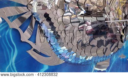 Mirror Fish Scale Decoration With Blue Background. Abstract Reflection In Mirrored Fish Scales