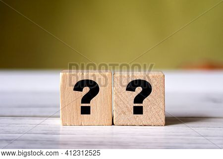 Quiz Concept Symbol With Question Mark On Wooden Cube Blocks. Support Or Questionnaire Background