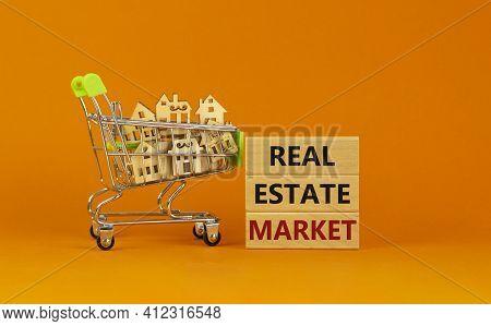 Real Estate Market Symbol. Wooden Blocks, Words 'real Estate Market' On Beautiful Orange Background.