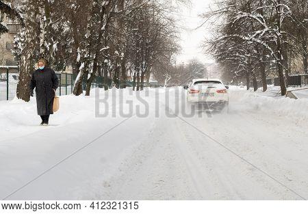 Lutsk, Ukraine - February 12, 2020: City Street After Blizzard. Record-breaking Amounts Of Snow. Peo