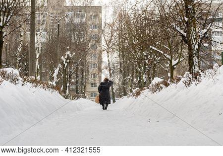 Lutsk, Ukraine - February 12,2020: People On Street After Snow Storm. City Street After Blizzard. Re
