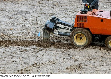 Tractor Used For Pipeline Earthworks A Digging A Ground Earth With Garden On Ground For Irrigation S