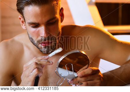 Shaving, Barber, Barber Shop. Close Up Portrait Of Bearded Man Shave With Razor In Bath In Bathroom.