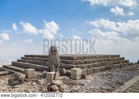 Statue Of Lion, Near Altar With Stairs. Located On Eastern Terrace Of Mount Nemrut, Kahta, Turkey, R