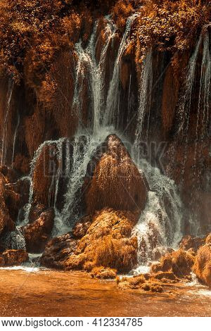 Autumn Gold Kravice Waterfall On The Trebizat River In Bosnia And Herzegovina. Fall Miracle Of Natur