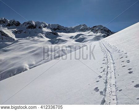 Ski Touring Track In A Grandiose Winter Landscape With High Mountains. Mountaineering In The Ducan V