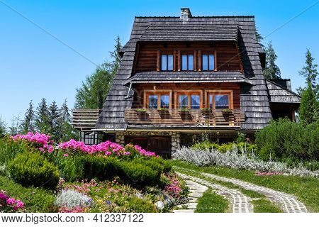 Incredibly beautiful park in the mountains with a wooden house