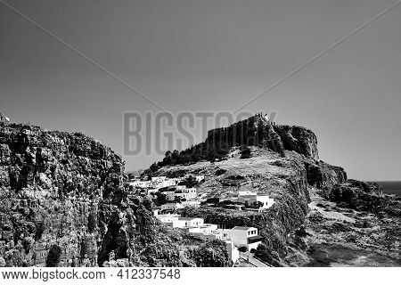 Medieval Fortress And White Houses Of Lindos Village In Rhodes, Monochrome