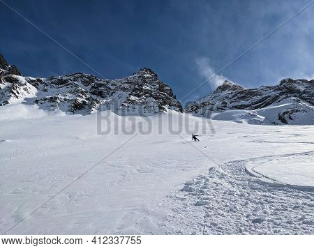 Freeride In Powder Snow In The Ducan Valley Above Davos. Big Mountains In Switzerland. Ski Touring M