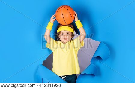 Little Basketballer. Child In Sportswear Throws Ball. Basketball Training. Sports Equipment. Kid Spo