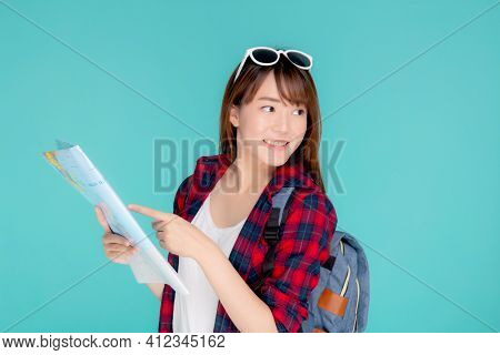 Beautiful Happy Young Asian Woman Travel Looking And Pointing A Paper Map Isolated On Blue Backgroun