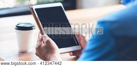 Man Using The Digital Tablet In The Morning For Searching Browsing Internet Data Information Network