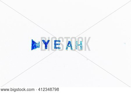 Blue Color Ink Of Rubber Stamp In Word Yeah On White Paper Background