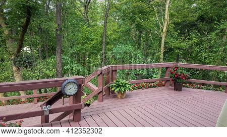 Backyard Deck Porch Patio Surrounded By Giant Lush Green Trees Forest In Summer