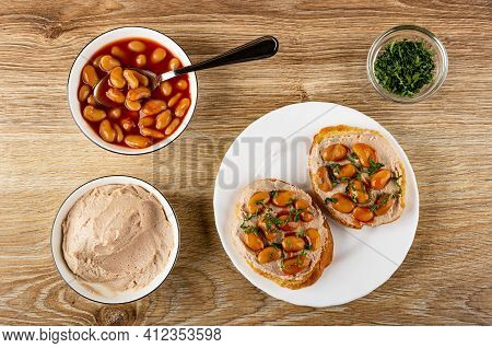 Teaspoon In Bowl With Canned Beans In Tomato Sauce, Meat Pate In Glass Bowl, Chopped Parsley In Tran
