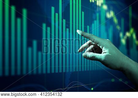 Businessman Touching Forex Charts And Diagrams Stock Market Display On Board. Investment And Trading