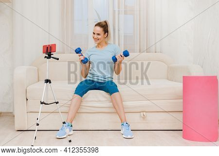 Young Female Fitness Trainer With Dumbbells Recording Video Blog, Work As A Trainer From Home Online